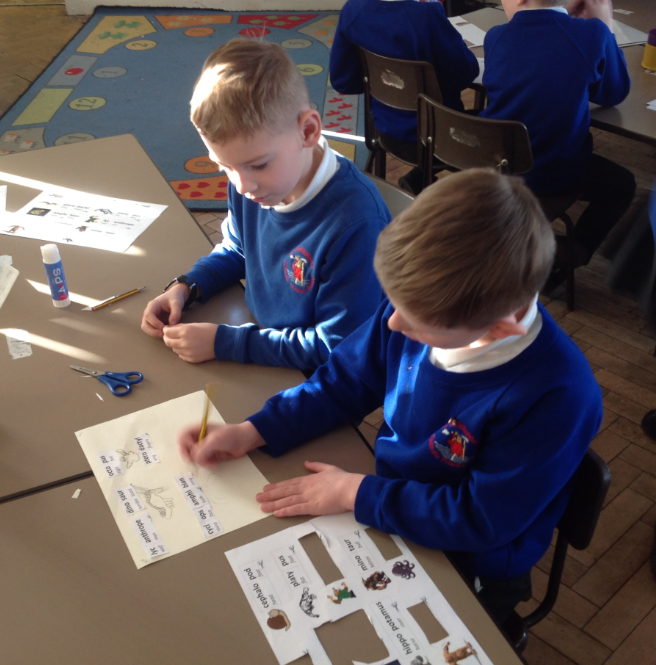Primary pupils working on a classics task